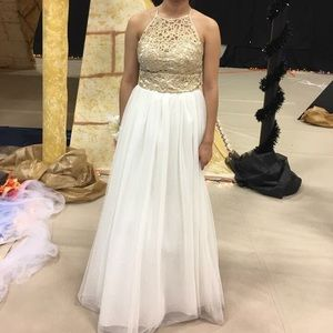 A gold/white prom dress